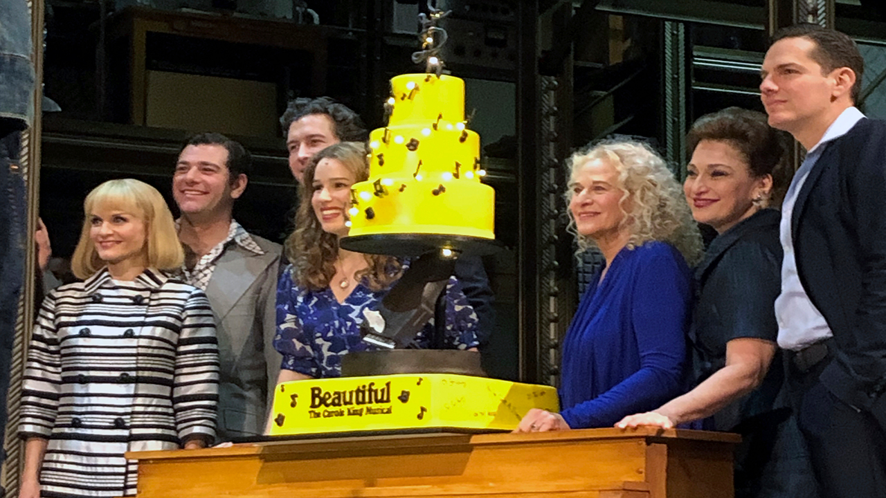 Carole King, third from right, poses for photos with the cast of Beautiful: The Carole King Musical at the Stephen Sondheim Theatre after a performance in New York.