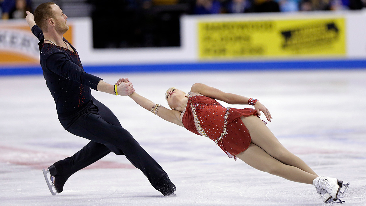 Caydee Denney and John Coughlin skate during the pairs short program at the U.S. Figure Skating Championships Thursday, 9, 2014 in Boston.