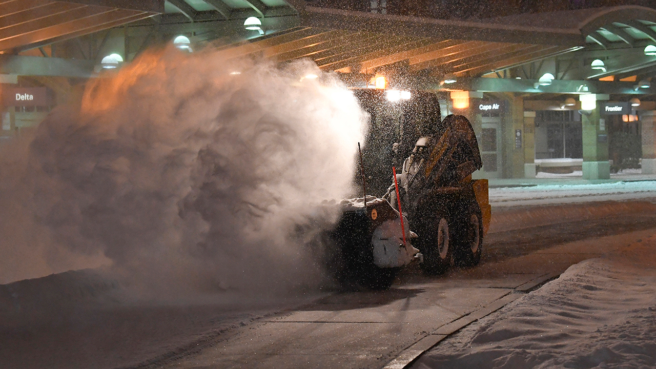 Crews clear snow at the Albany International Airport in Colonie, N.Y., Sunday, Jan. 20, 2019.