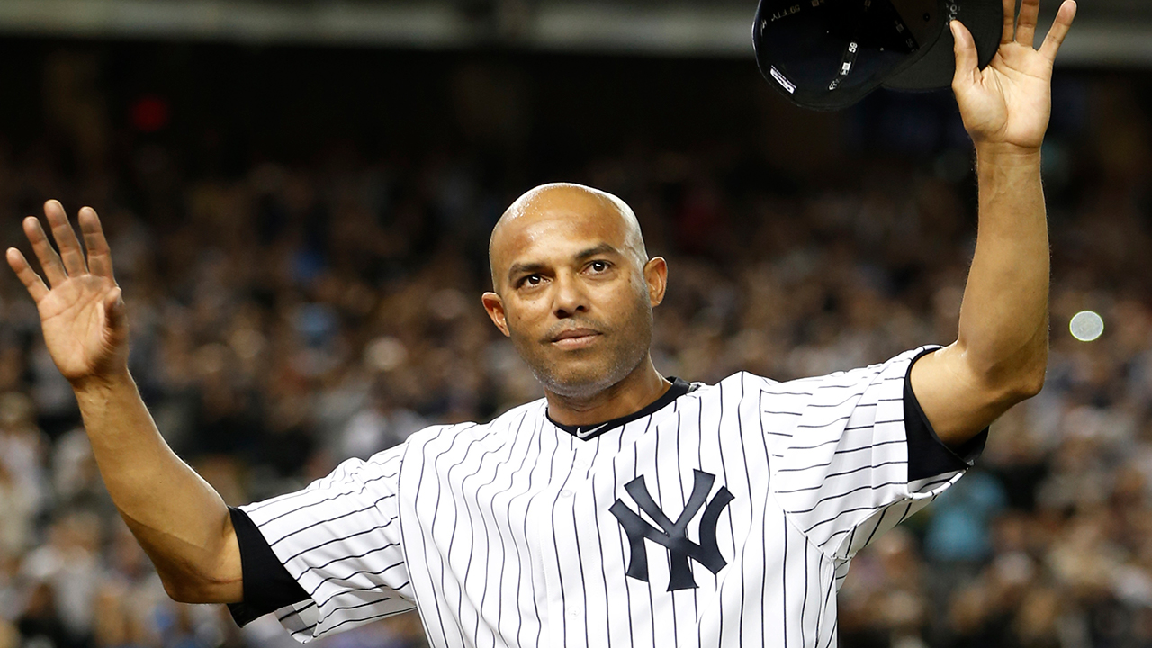 In this Sept. 26, 2013 photo, Mariano Rivera acknowledges a standing ovation after coming off the mound in the ninth inning of his final appearance, at Yankee Stadium in New York.