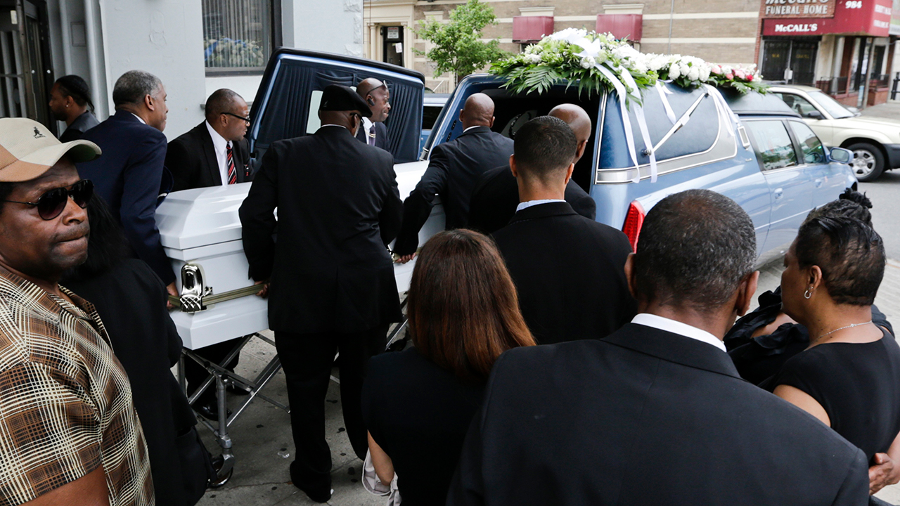 In this June 16, 2015 file photo, the casket bearing Kalief Browder is loaded into a hearse after his funeral service in the Bronx.