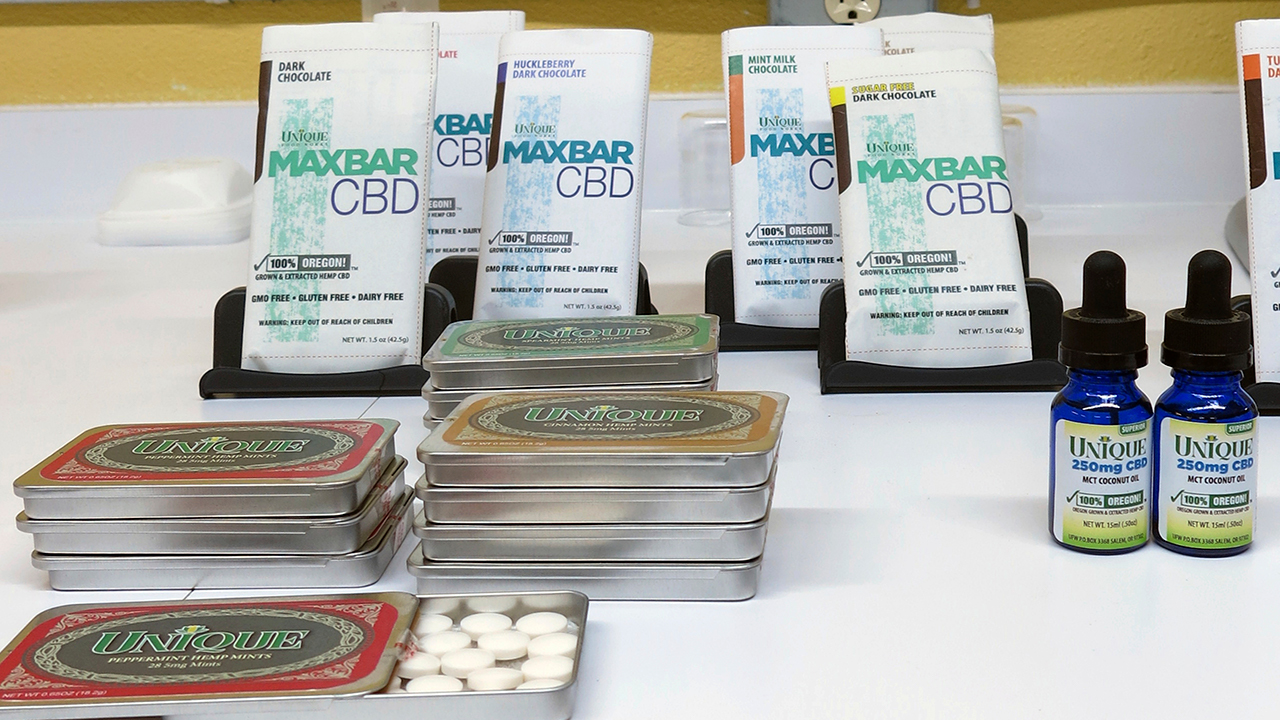 In this April 16, 2018 photo, products containing cannabidiol, or CBD, are on display at Unique Food Works, a state-licensed hemp handling facility in Salem, Ore.