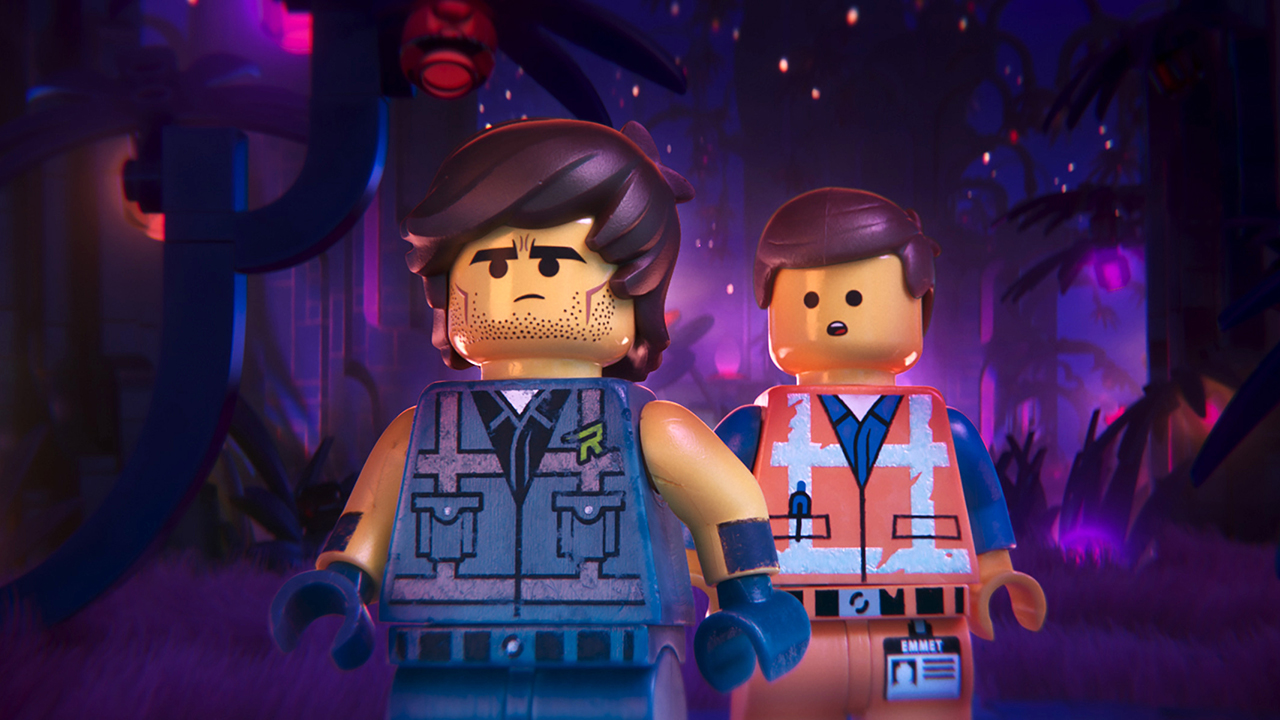 This image released by Warner Bros. Pictures shows the characters Rex Dangervest, left, and Emmet, both voiced by Chris Pratt, in a scene from The Lego Movie 2: The Second Part.