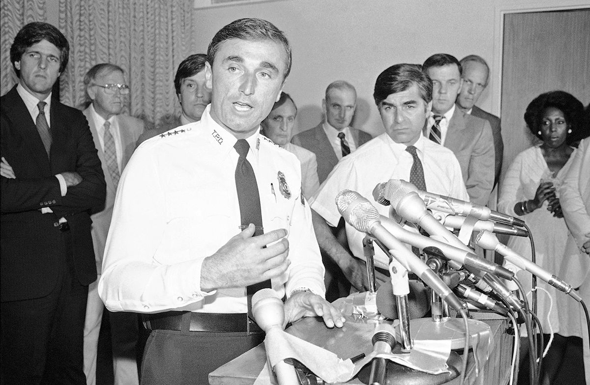 Mass. Bay Transportation Authority Police Chief William J. Bratton, left, answers questions at a news conference at the McCormack Building in Boston on Wednesday, July 20, 1983.