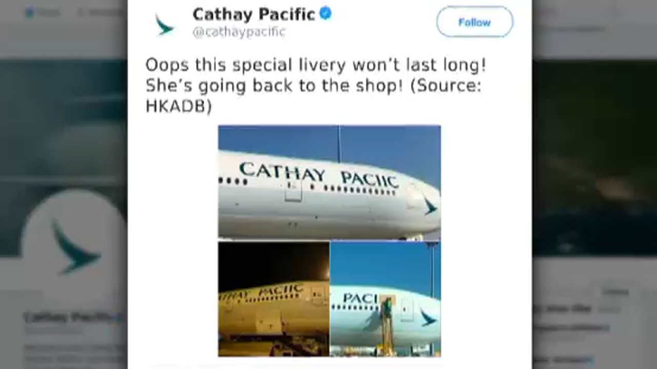 Big spelling error painted on the side of a Cathay Pacific plane