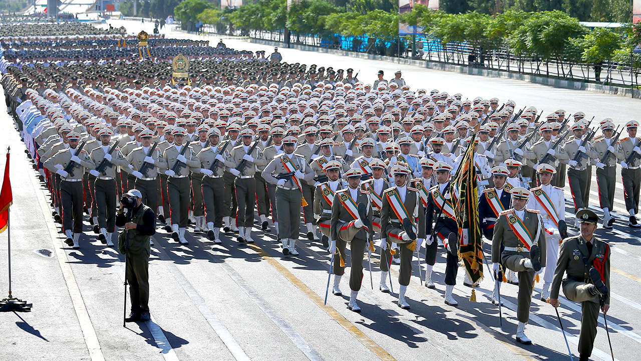 Iranian armed forces members march in a military parade marking the 38th anniversary of Iraqs 1980 invasion of Iran.