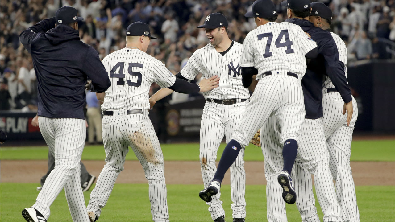 The New York Yankees celebrate after beating the Oakland Athletics 7-2 in the American League wild-card playoff baseball game, Wednesday, Oct. 3, 2018.