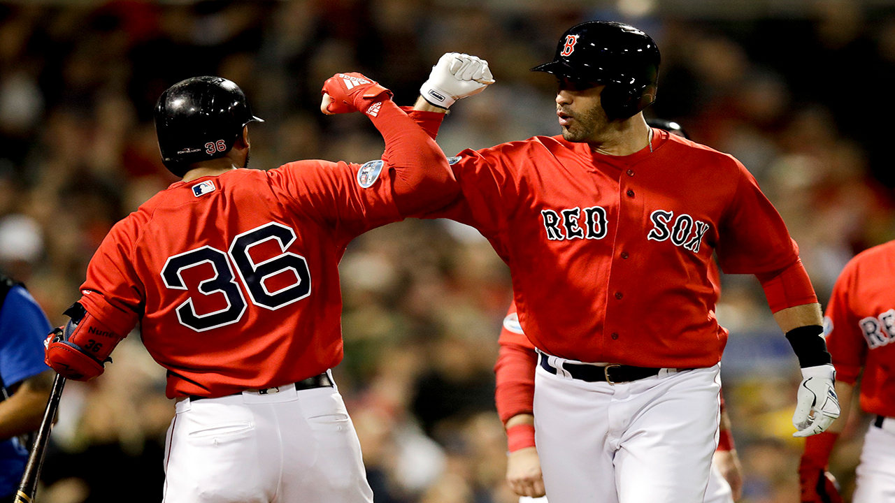 Red Soxs J.D. Martinez celebrates after his three-run home run with Eduardo Nunez during the first inning of Game 1 against the Yankees in Boston. (AP Photo/Charles Krupa)