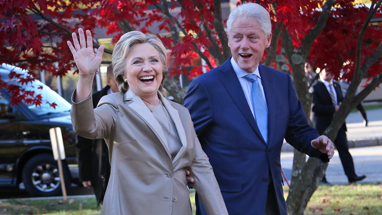 Hillary Clinton, and her husband former President Bill Clinton, greet supporters after voting in Chappaqua, N.Y., Tuesday, Nov. 8, 2016.