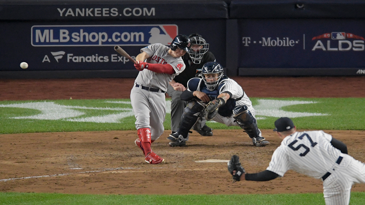 Boston Red Soxs Brock Holt connects for a two-run triple against the New York Yankees during the fourth inning of Game 3.