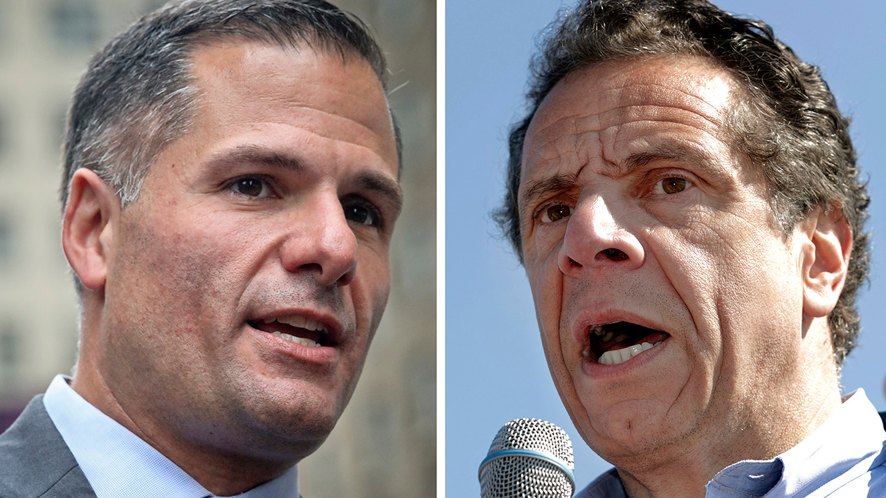 Marc Molinaro, left, speaks at a news conference in New York on Sept. 14, 2018, and New York Gov. Andrew Cuomo speaks a news conference in in Tarrytown; N.Y., on May 8, 2018.