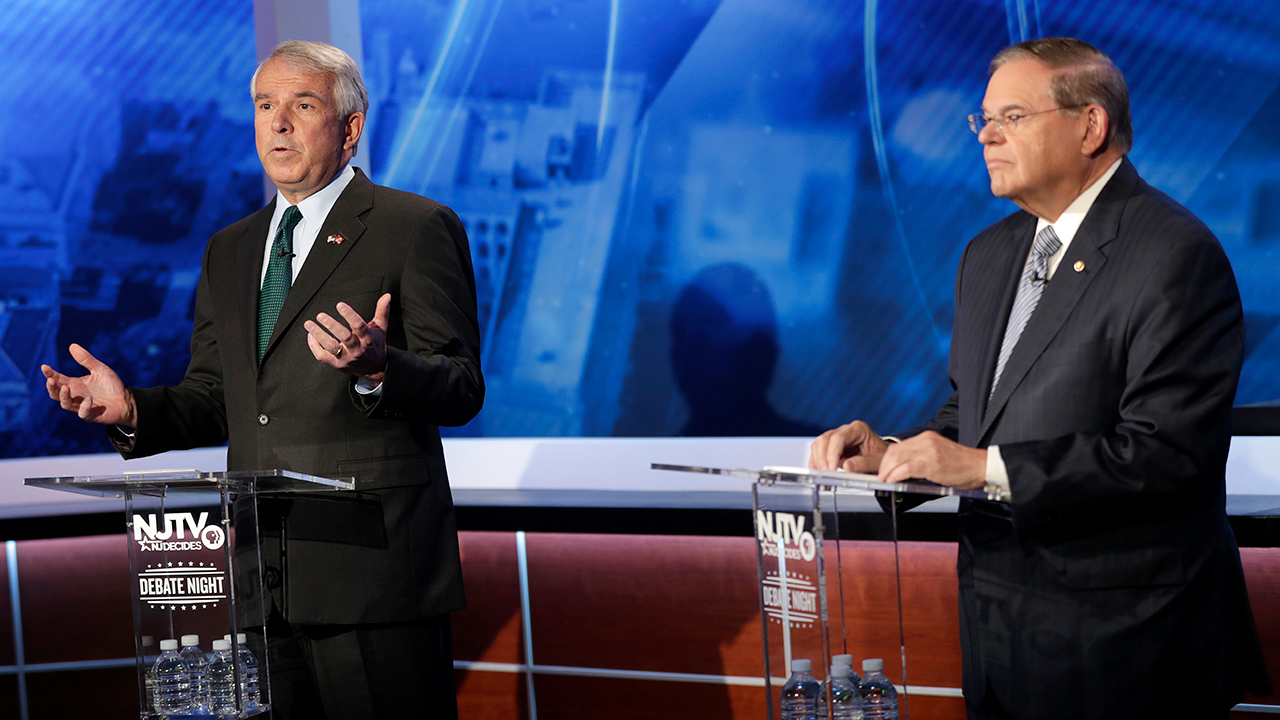 Bob Hugin, left, the Republican candidate for the U.S. Senate race in New Jersey, speaks during debate with Sen. Bob Menendez, the Democrat candidate, in Newark, N.J.