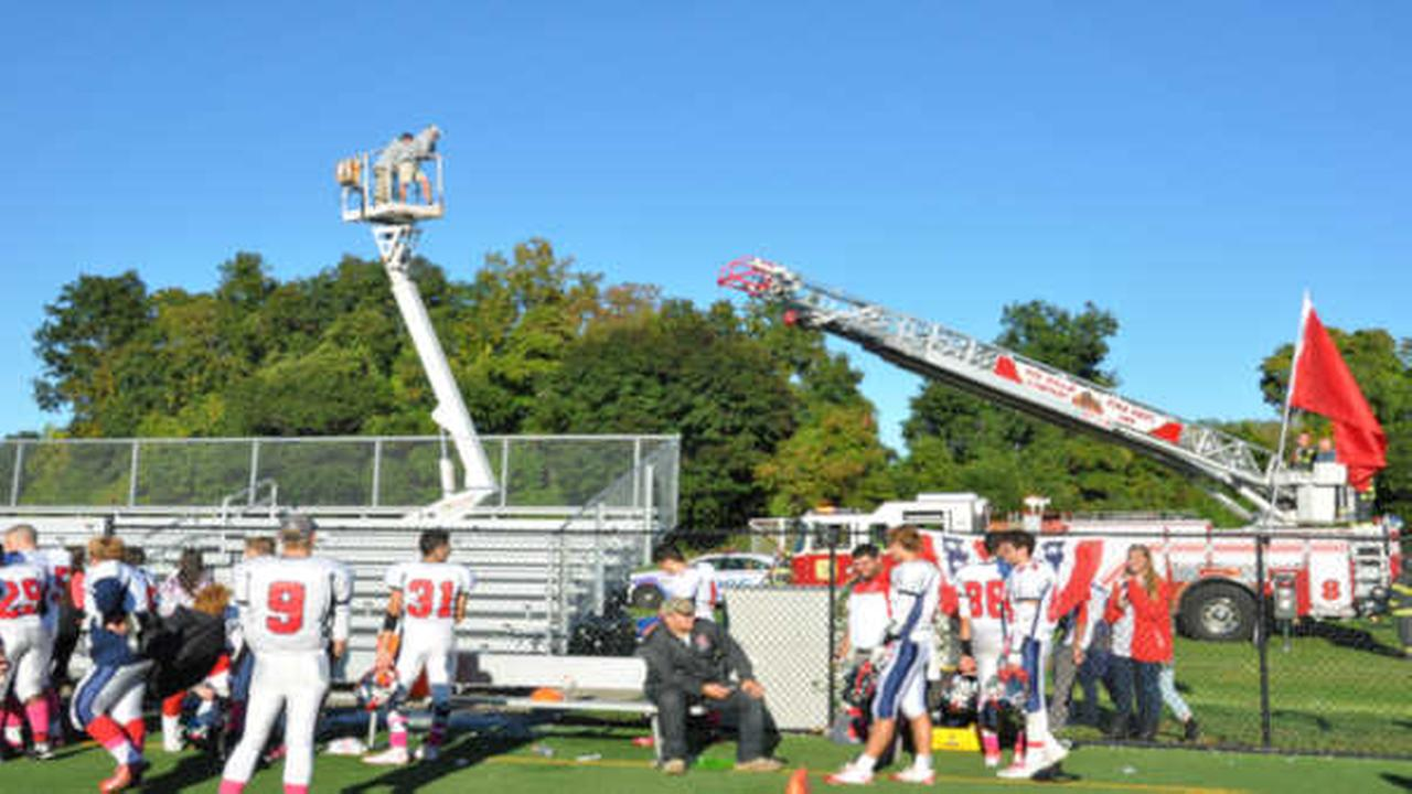 Smithtown football coaches rescued after stuck in air on bucket truck