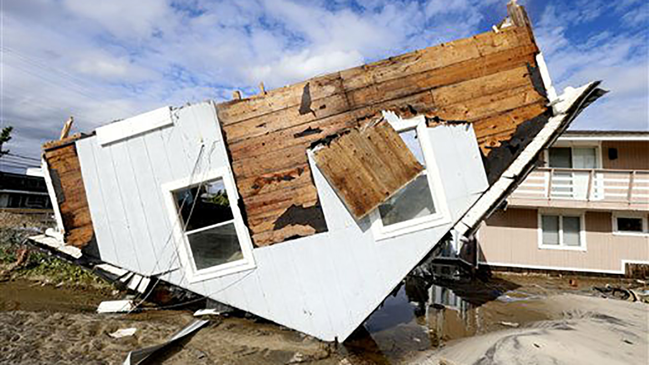 Part of a home rests upside-down in Seaside Heights, New Jersey, on Wednesday, October 31, 2012 after Superstorm Sandy made landfall.