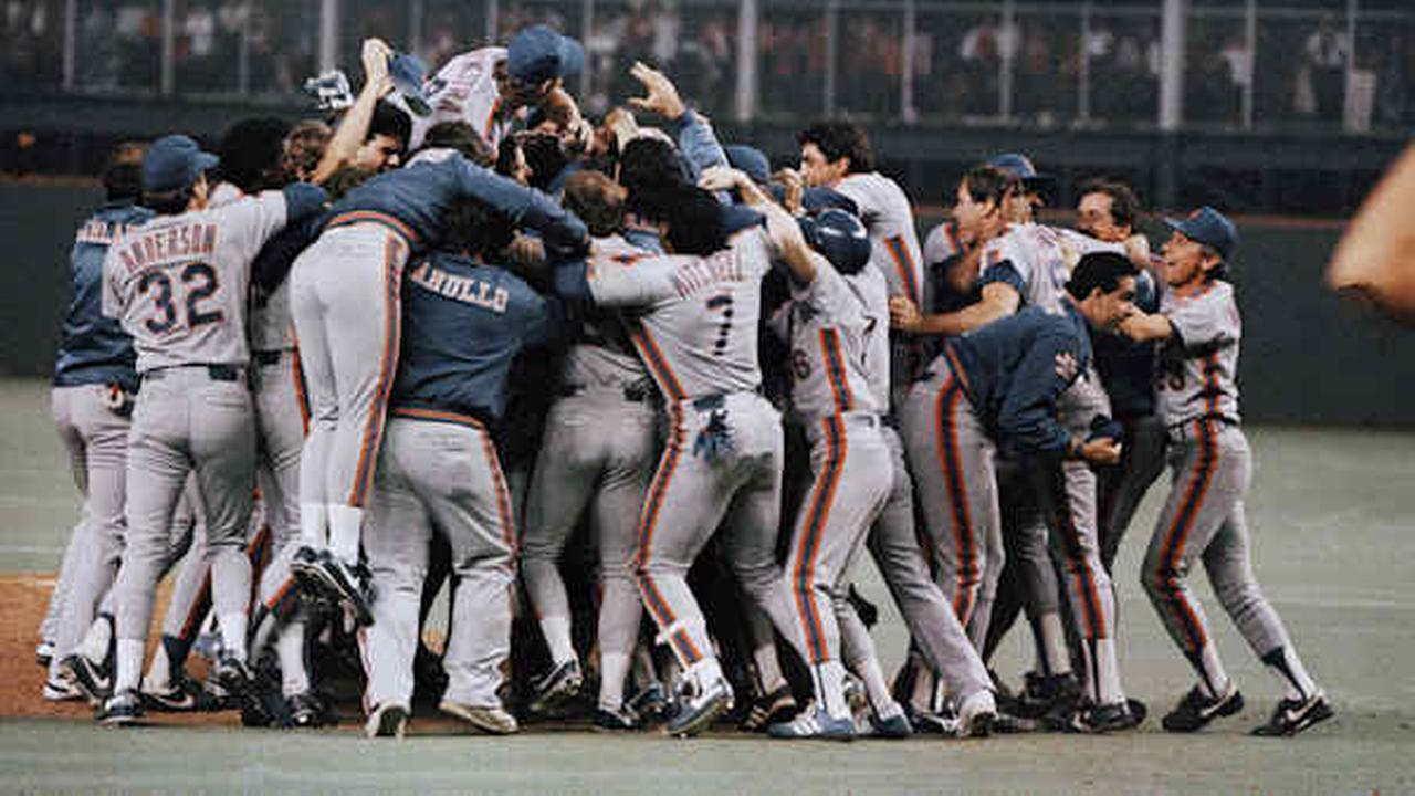 The New York Mets celebrate on the field after winning the National League Pennant in Houston Wednesday night. October 15, 1986.