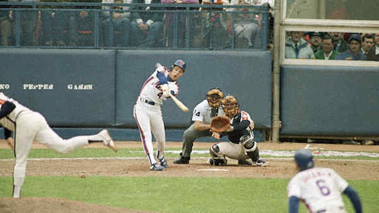 Lenny Dykstra swings through his bottom of the ninth, two-run homerun against Dave Smith of the Houston Astros in Game 3 of the NLCS, Saturday, Oct. 11, 1986.