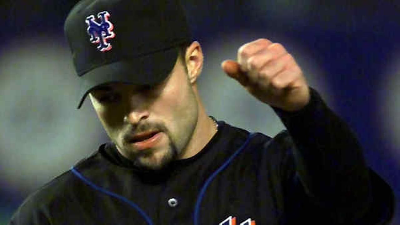 Mets pitcher Mike Hampton reacts during the seventh inning of Game 5 of the NLCS against the St. Louis Cardinals Monday, Oct. 16, 2000, in New York.