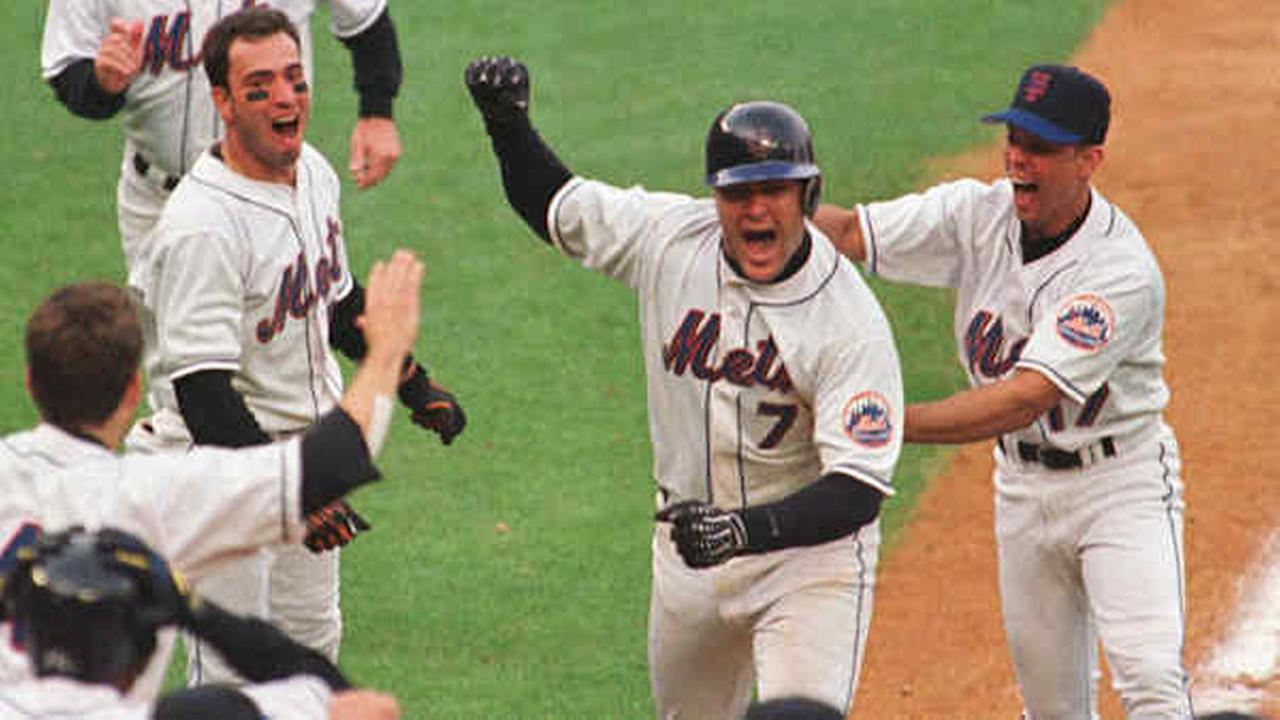Todd Pratt celebrates with his teammates after hitting the game-winning home run in the tenth inning of Game 4 of the NLDS against the Diamondbacks Saturday, Oct. 9, 1999.