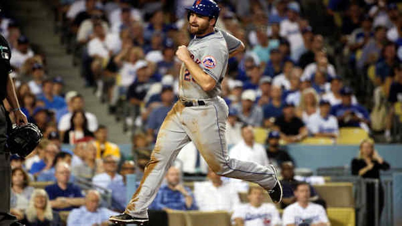 Daniel Murphy scores from third off a sacrifice fly by Travis dArnaud during the fourth inning in Game 5 of baseballs NLDS against the Dodgers Thursday, Oct. 15, 2015.