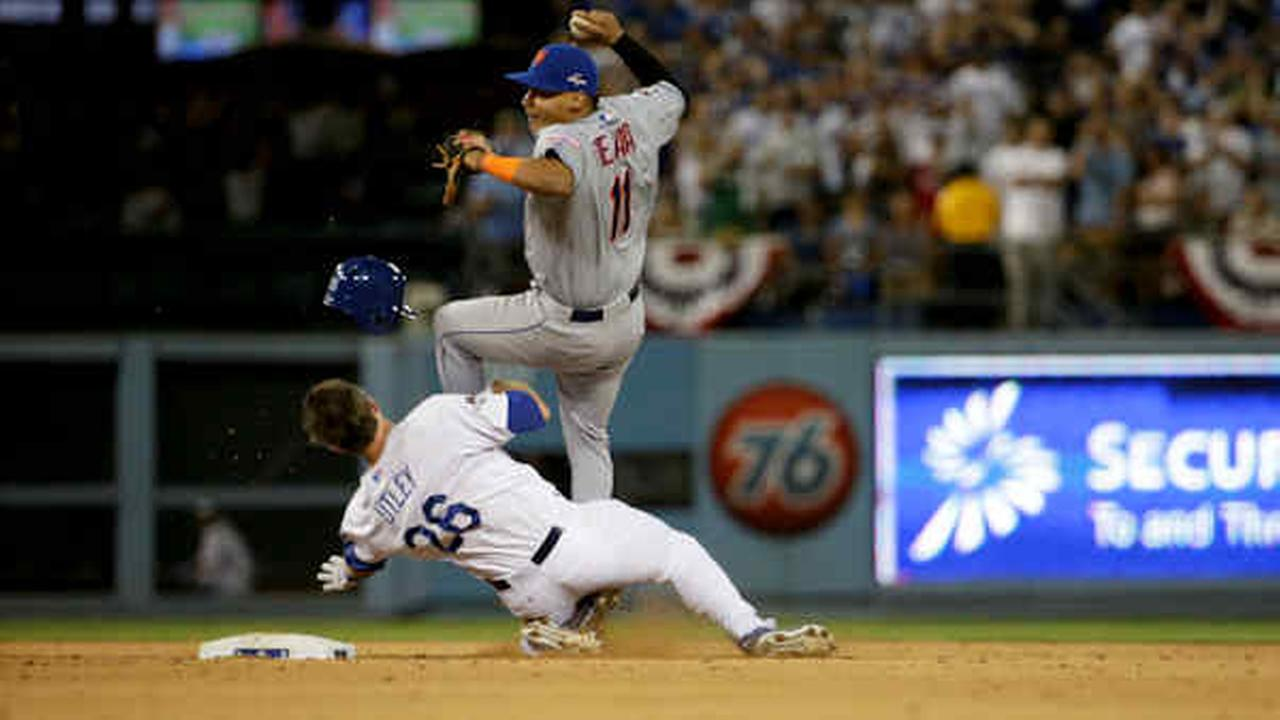 Mets shortstop Ruben Tejada goes over the top of the Dodgers Chase Utley who broke up a double play during the seventh inning in Game 2 of baseballs NLDS, Saturday, Oct. 10, 2015