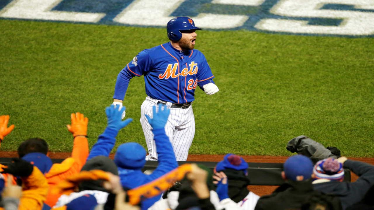 New York Mets Daniel Murphy celebrates after hitting a two-run home run during the first inning of Game 2 of the National League baseball championship series against the Cubs.