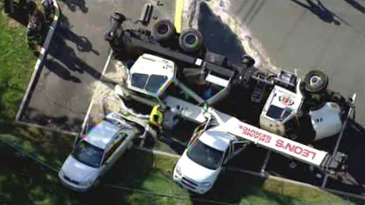Crane truck overturns in Oradell, crushing parked cars