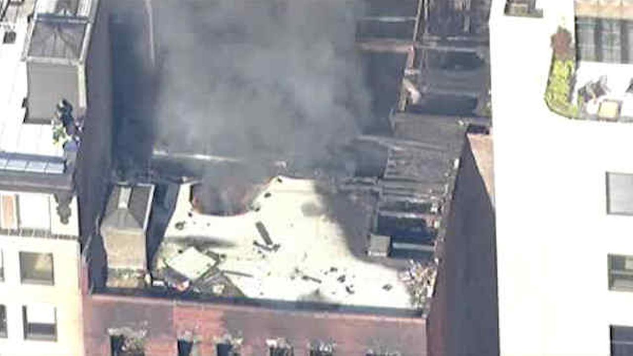 Fire that tore through Chelsea building reignites; FDNY dousing smoldering rubble