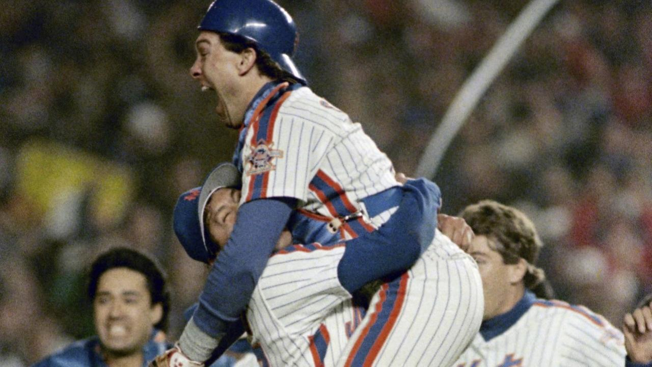 In this Oct 27, 1986 file photo, New York Mets catcher Gary Carter, right, is lifted in the air by relief pitcher Jese Orosco following the Met 8-5 victory over the Boston Red Sox.