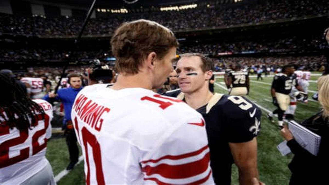New Orleans Saints quarterback Drew Brees (9) trees New York Giants quarterback Eli Manning (10) after their NFL football game in New Orleans, Sunday, Nov. 1, 2015.