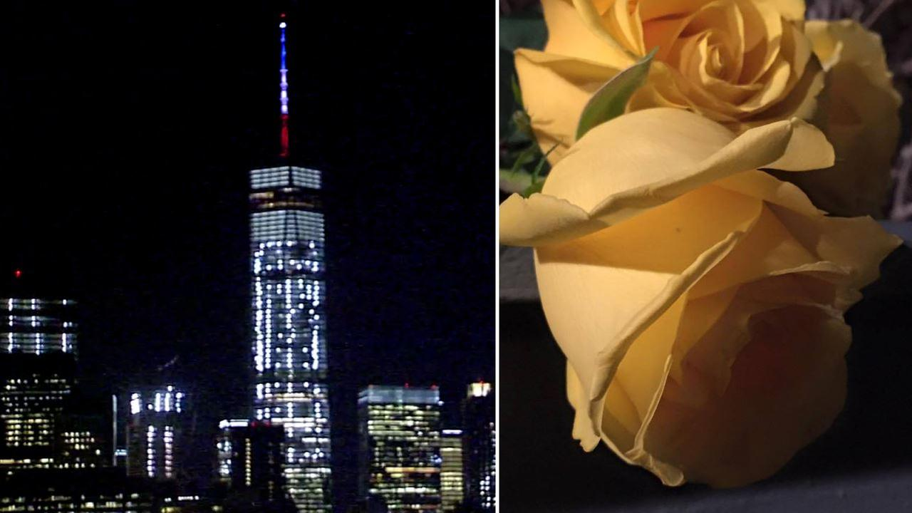New York City pays tribute to Paris attack victims with World Trade Center lighting, flowers