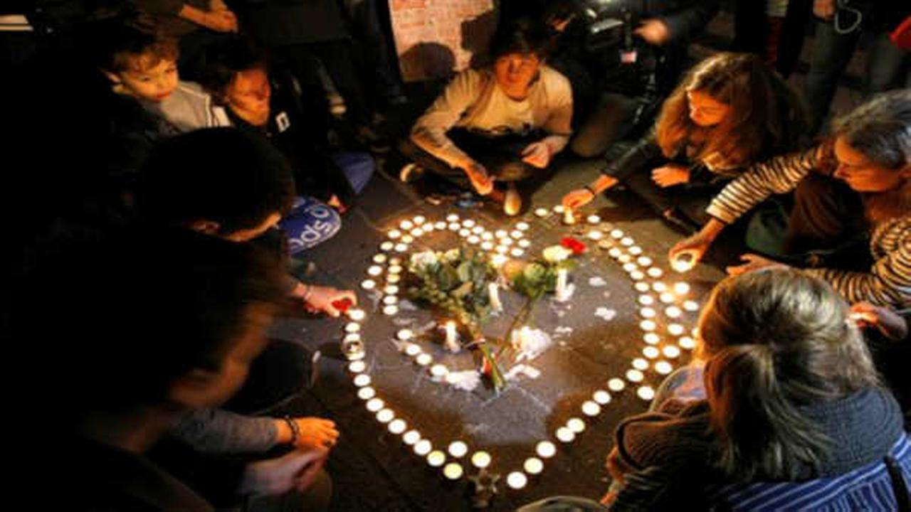 People light candles in the shape of a heart, on the Old-Port in Marseille, southern France.