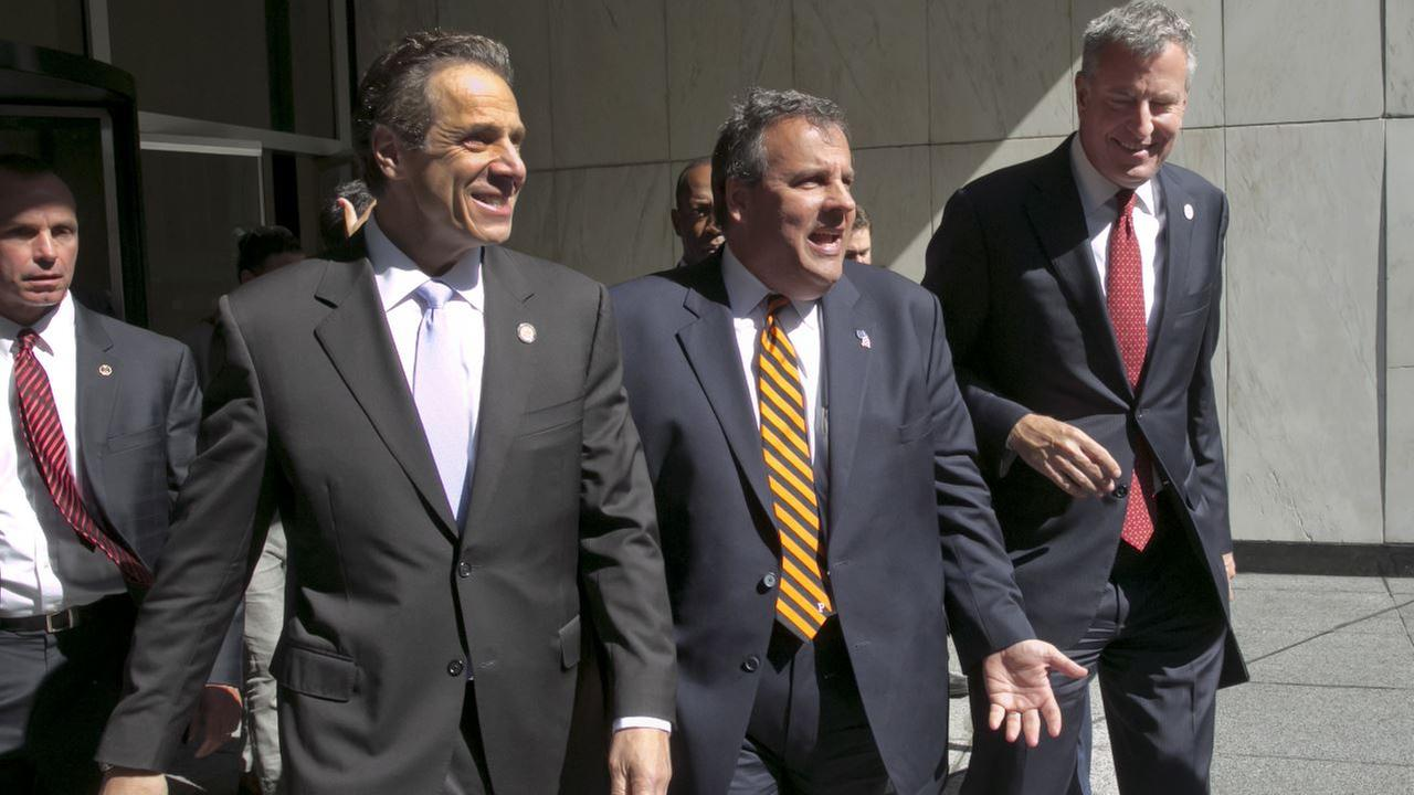 New York Gov. Andrew Cuomo, left, New Jersey Gov., Chris Christie, center, and New York Mayor Bill de Blasio leave a press conference following a security meeting, in New York.