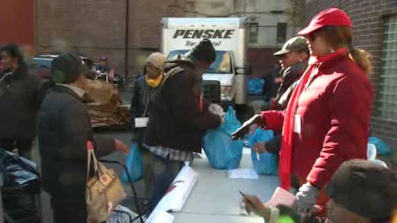 Volunteers distributing food packages to needy families at NYC churches