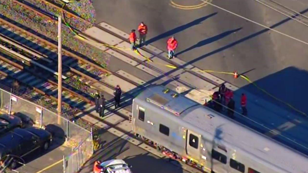 LIRR train hits car on tracks at crossing in Huntington Station