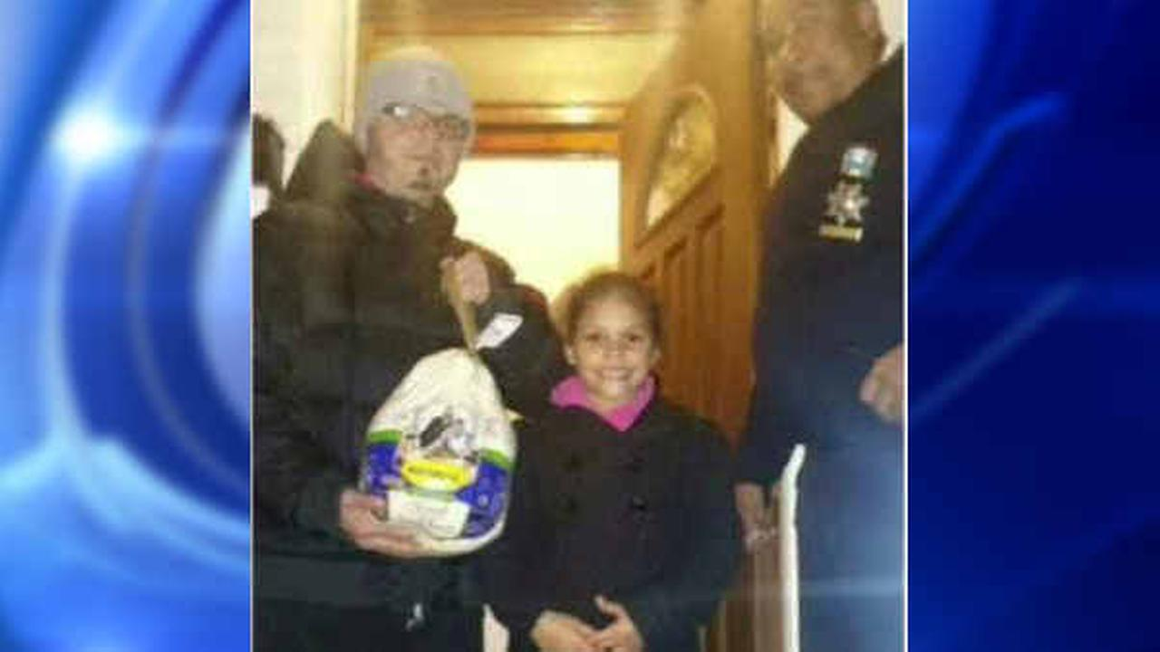 7-year-old Bronx girl who survived shooting given turkey by NYPD officers