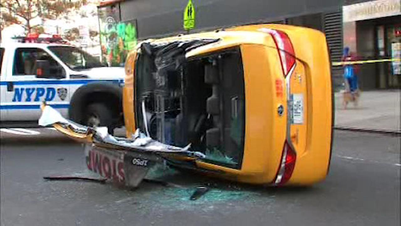Taxicab overturns on the Upper East Side, 1 critically hurt