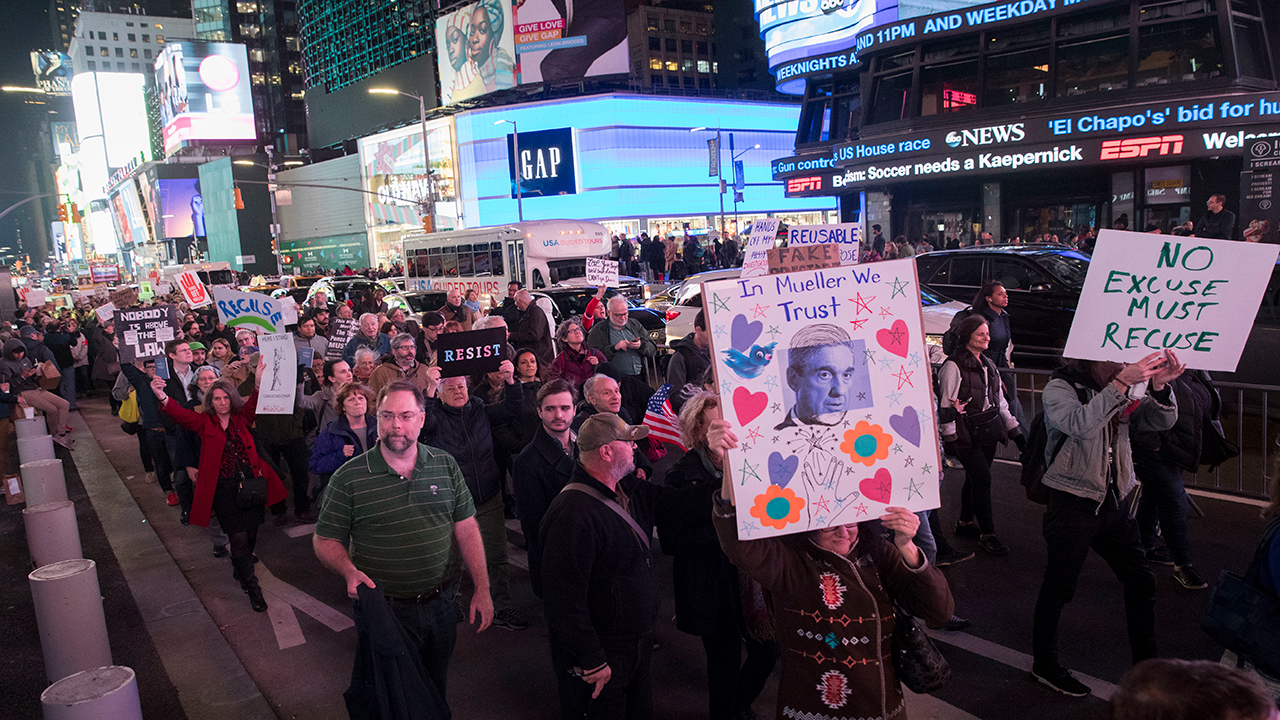 Protesters march through Times Square during a demonstration in support of special counsel Robert Mueller, Thursday, Nov. 8, 2018, in New York.