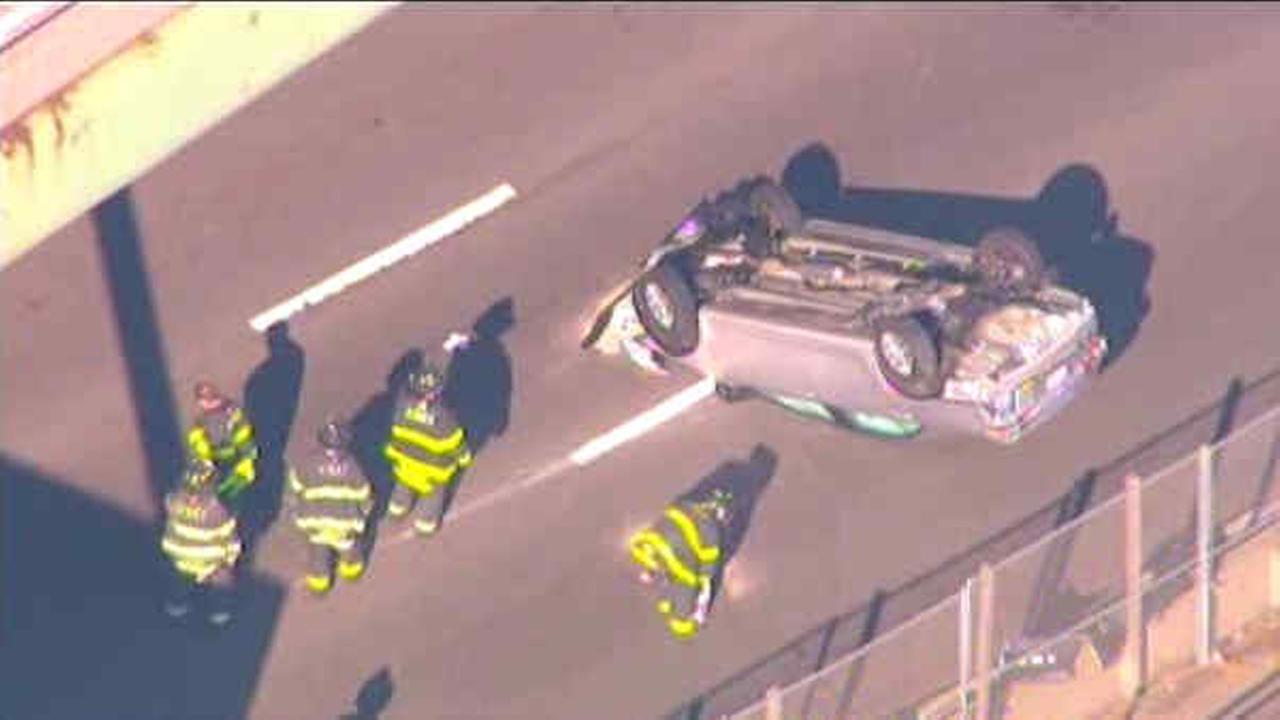 FDR crash involving police cruiser leaves car overturned, 3 hurt
