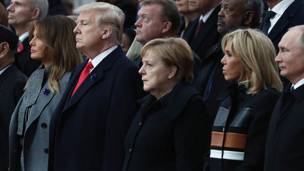 Russian President Vladimir Putin. Brigitte Macron, French President Emmanuel Macron, German Chancellor Angela Merkel, President Trump and first lady Melania Trump attend ceremony.