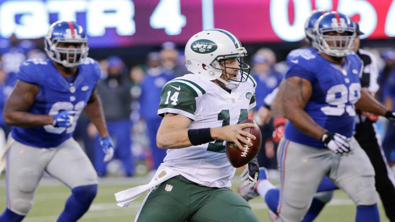 New York Jets quarterback Ryan Fitzpatrick (14) rushes during the second half of an NFL football game against the New York Giants