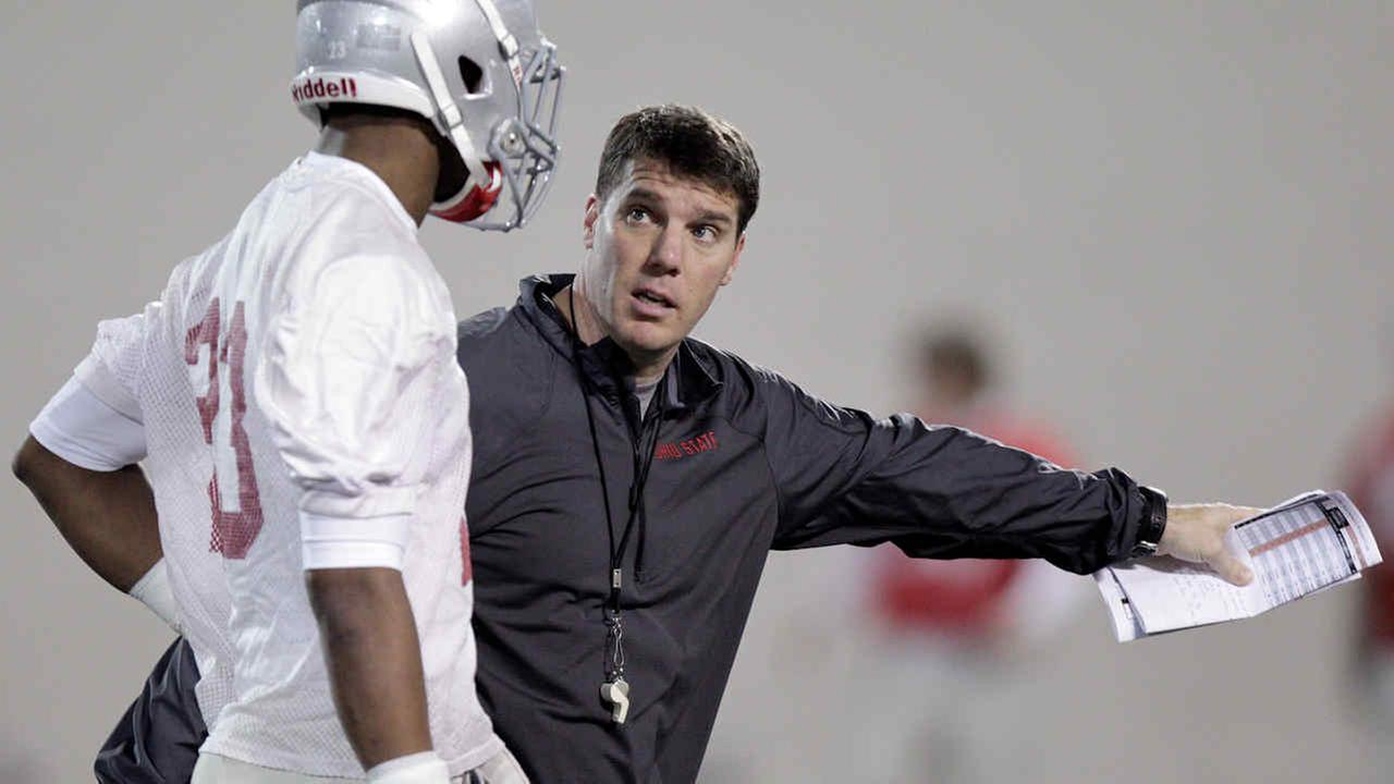 New Rutgers football coach Chris Ash instructs Ohio State defensive back Tyvis Powell on Tuesday, March 4, 2014
