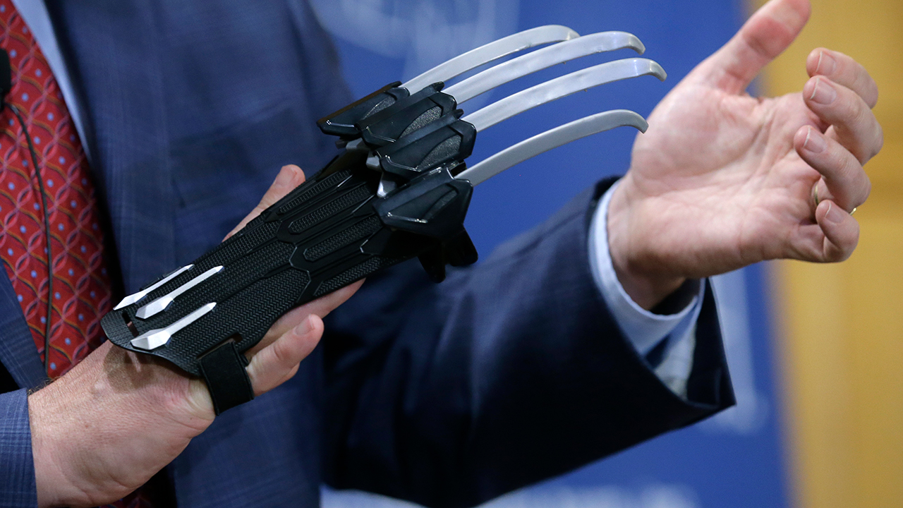 James Swartz, hands only, director of the Massachusetts-based consumer safety group World Against Toys Causing Harm, or W.A.T.C.H., displays a Black Panther slash claw.
