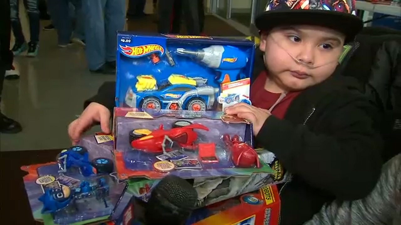 For 20 years, holiday toy event brings children joy at Queens children's hospital