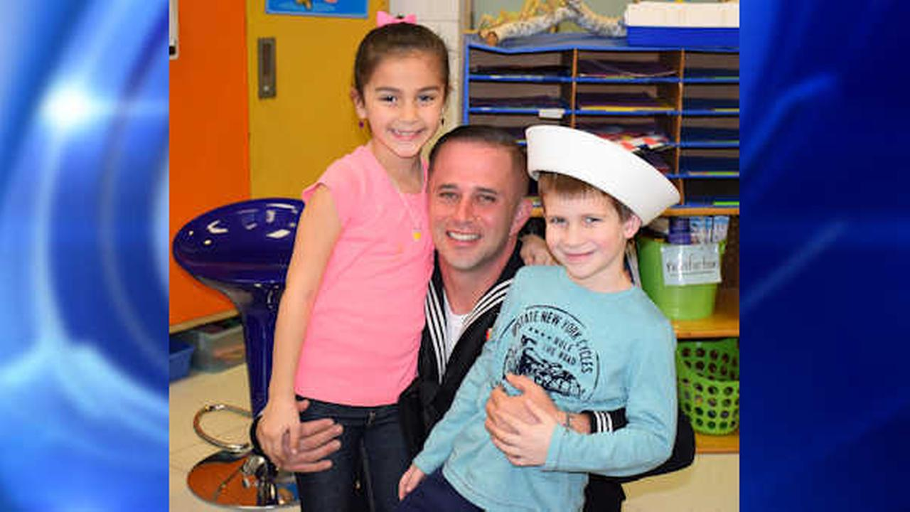 Returning Navy officer surprises niece and nephew at Long Island school for the holidays