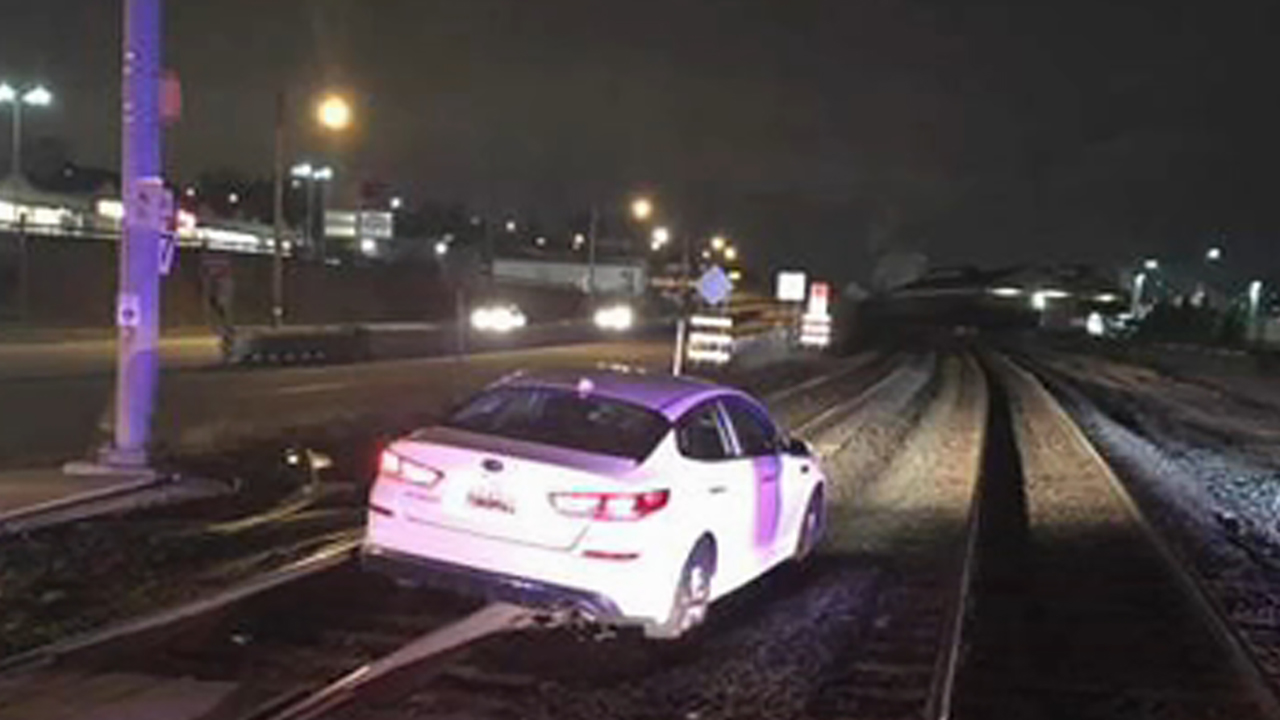 Woman says her GPS told her to drive onto railroad tracks
