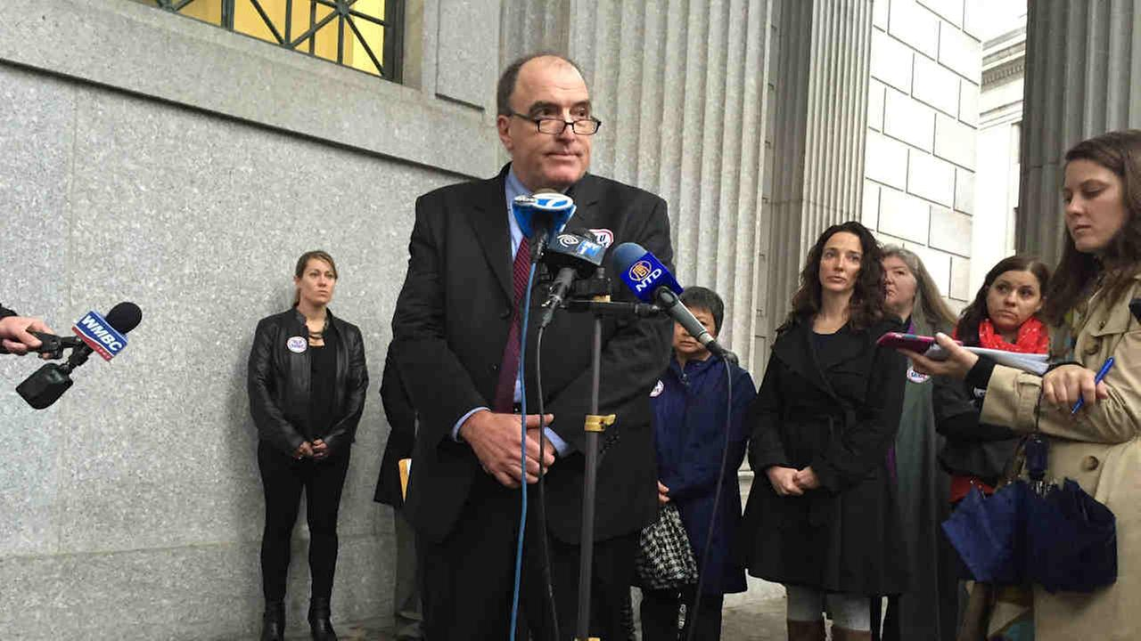 John Gilmore, executive director of Autism Action Network, speaks at a news conference on Centre Street Thursday morning.