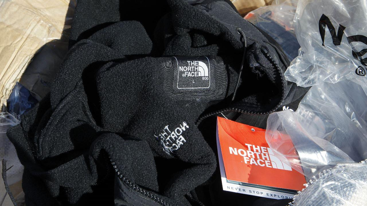 In this Dec. 9, 2010 file photo, a fake The North Face jacket rests in one of many boxes full of the fake name-brand clothing that police seized from a vendor in NJ.