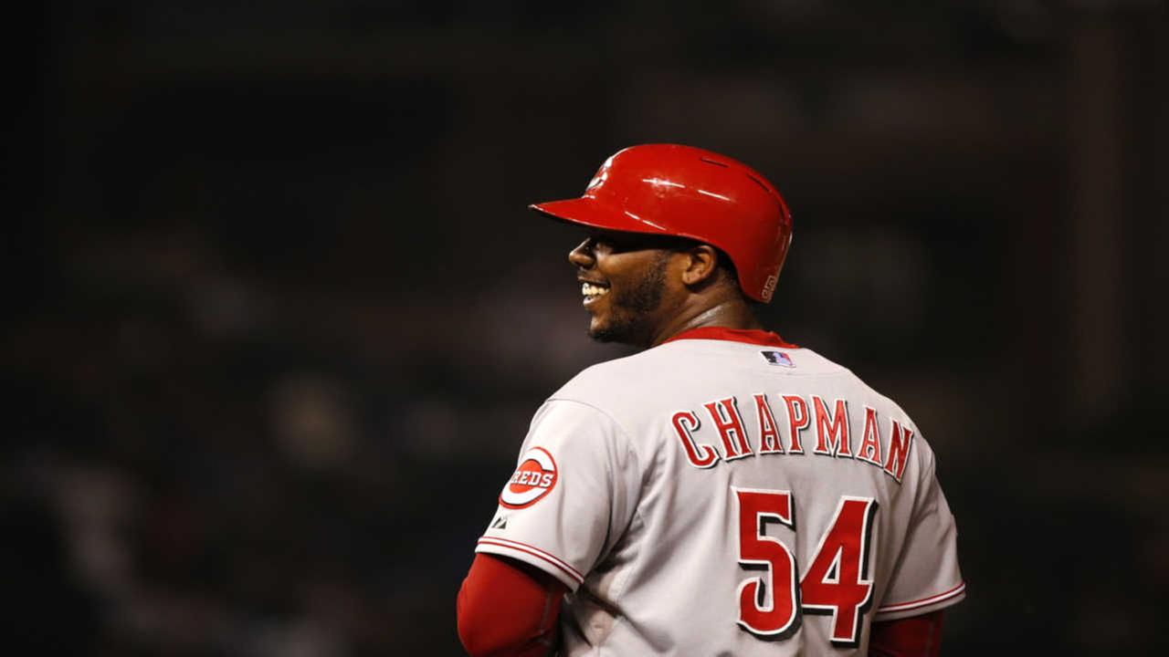 Cincinnati Reds Aroldis Chapman smiles after he reached first on a missed catch error
