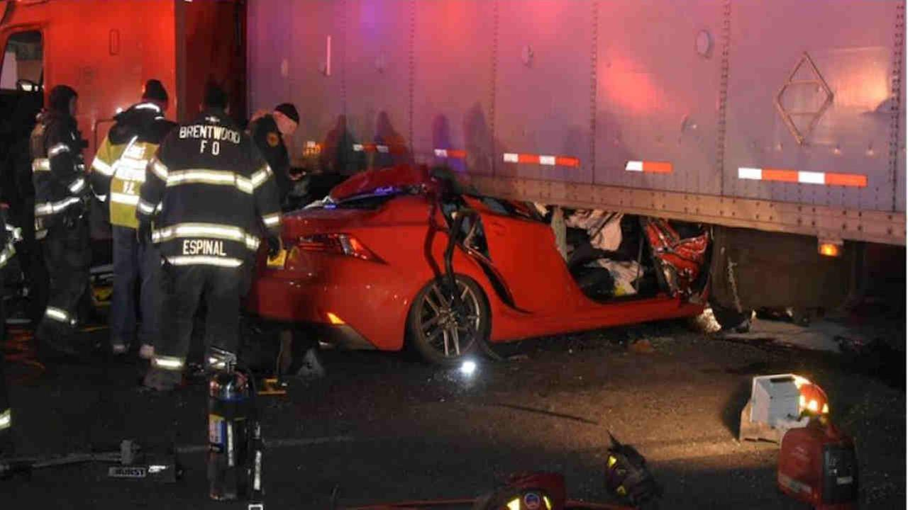Car crashes in Bay Shore, gets wedged under tractor-trailer