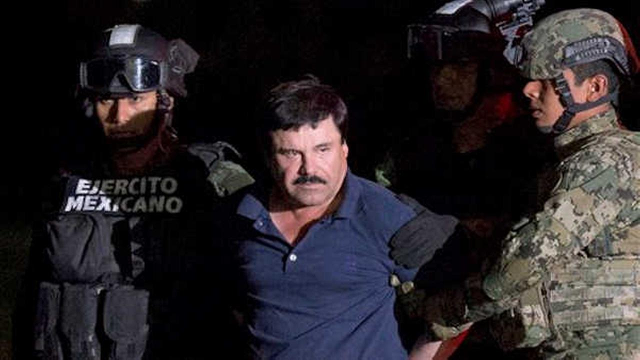 Joaquin El Chapo Guzman is escorted by soldiers and marines to a waiting helicopter. (AP Photo/Rebecca Blackwell)